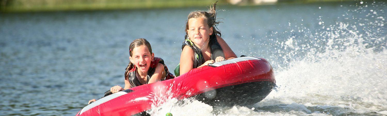 Kids on a tube in a lake